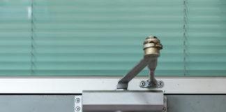 How to Adjust a Self-Closing Door Mechanism