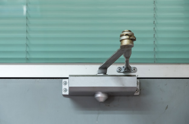 How to Adjust a Self-Closing Door Mechanism